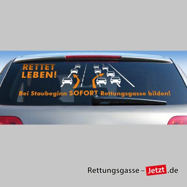 """Heckscheibenaufkleber: """"Bei Staubeginn SOFORT Rettungsgasse bilden!"""" - Weiss / Orange"""